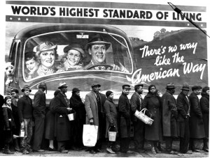 Photo #: 5562885 Date Taken: 02-00-1937 Description: African American flood victims lined up to get food & clothing fr. Red Cross relief station in front of billboard extolling WORLD'S HIGHEST STANDARD OF   LIVING/ THERE'S NO WAY LIKE THE AMERICAN WAY. City: LOUISVILLE State: KY Country: US Photographer: MARGARET BOURKE-WHITE/TimePix