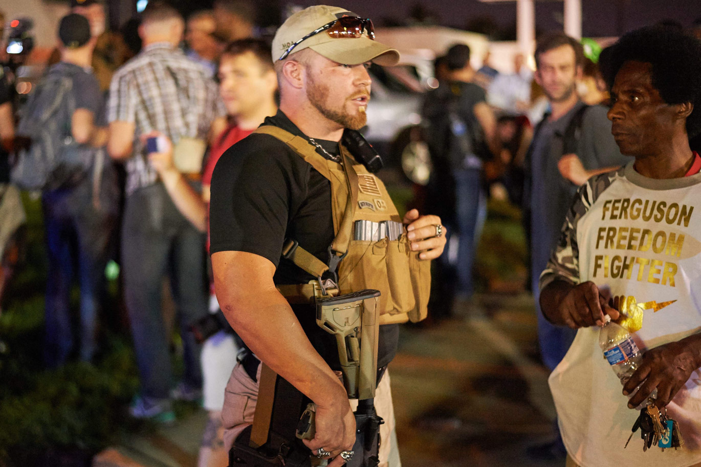 A member of the Oath Keepers brandishing a semiautomatic weapon during protests in Ferguson, August 2015.