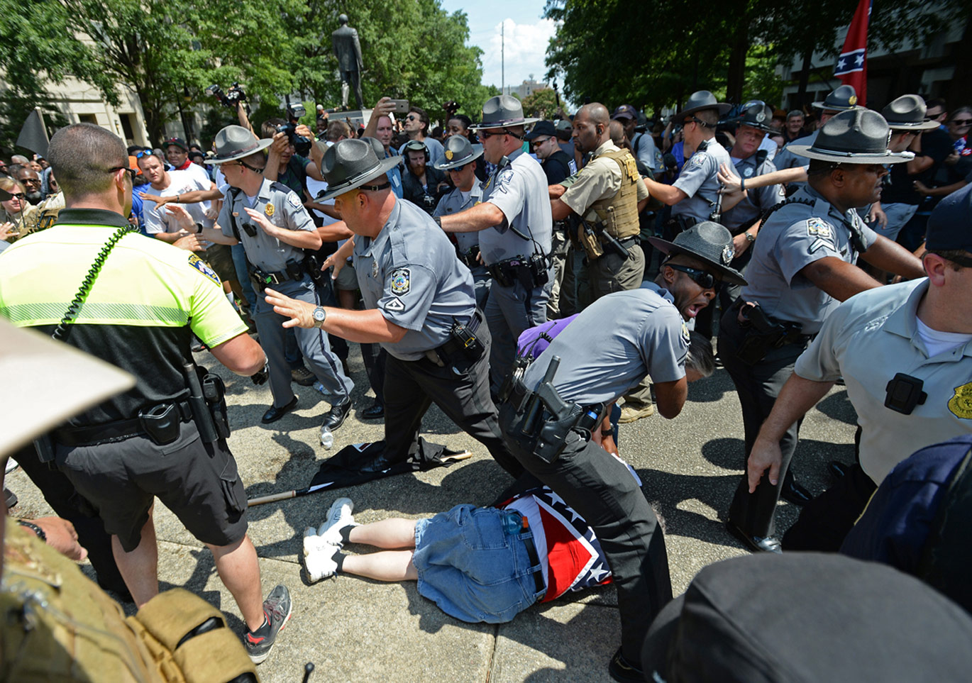 Police struggle to protect Klansmen on July 18, 2015.