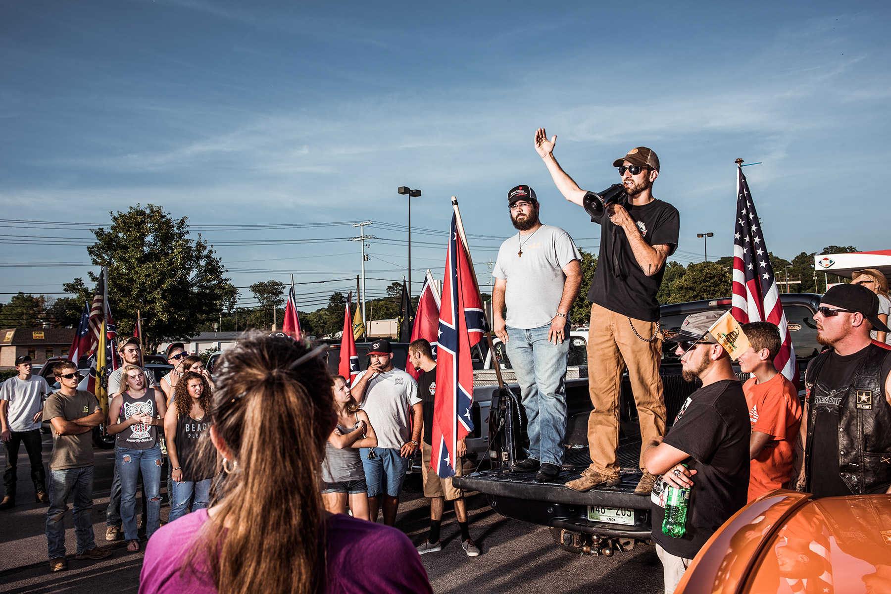 Tom Piece, right and Mathew Heimbach, tailgate left, deliver speeches during a confederate flag rally held in a parking lot in Seymour, Tennessee on Thursday, July 17, 2015. After rallying the crowd with talk of their heritage being under attach from the federal government, the two prompted the group to drive with flags raised through Knoxville. Mike Belleme for Al Jazeera America