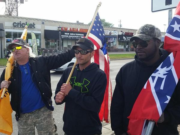 Close-up of the white supremacists. The one in the middle's name in Jason Thomas. The one on the right's name is BC Johnson, who organized a cancelled Confederate Flag rally at the capital earlier this month.