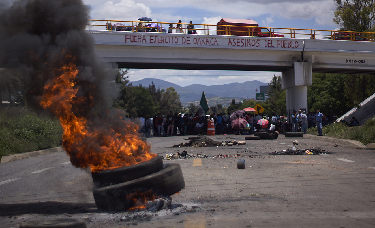 "Day 11 of the Nochixtlán blockade. ""Army out of Oaxaca. Murderers of the people."""