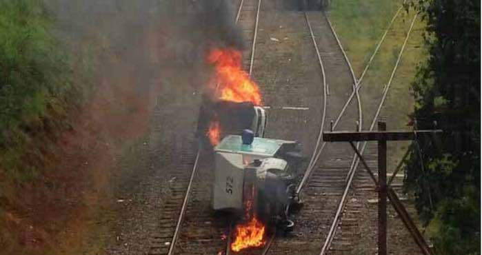 Trucks set alight on train tracks in Michoacán.