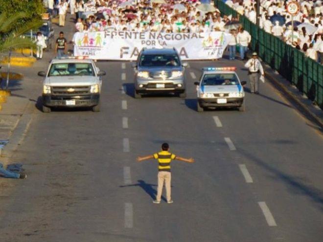 boy-blocks-homphobic-march-mexico