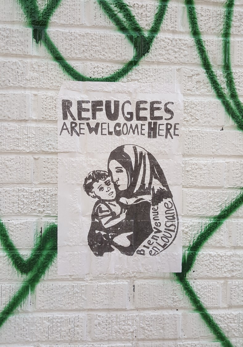Refugee on graffiti 2.jpg