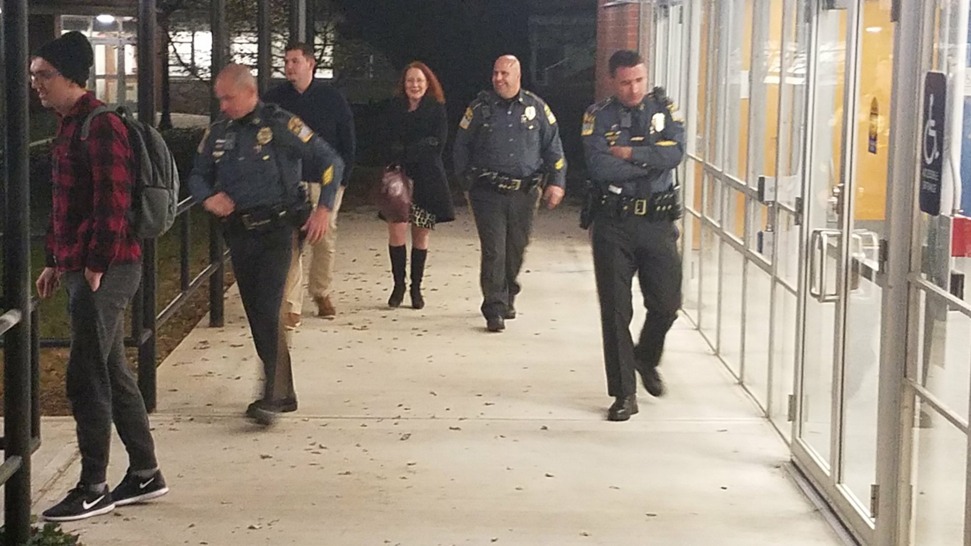 Daugherty and her security detail.jpg